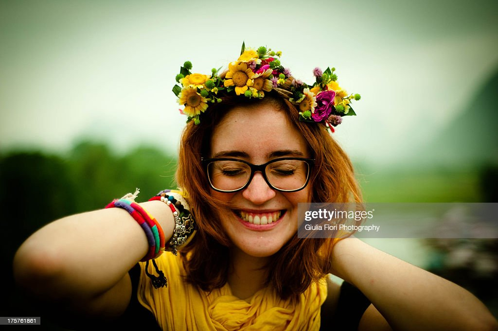 Girl smiling with flowers on her head