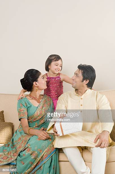 Girl smiling with her parents