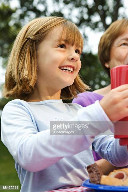 Girl smiling with ketchup bottle