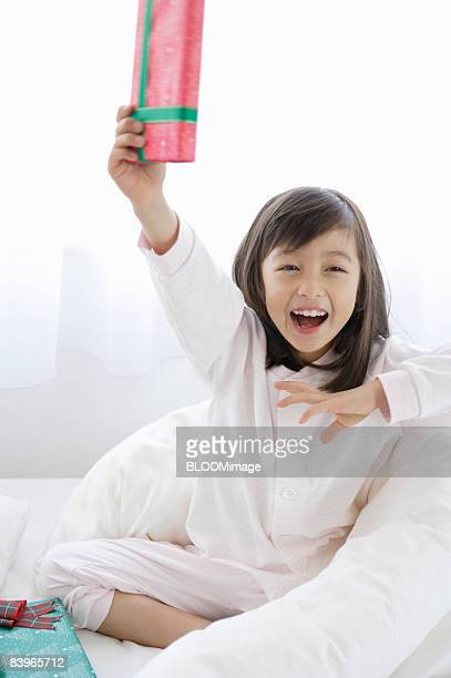 Girl smiling with present in hand