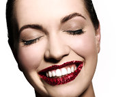 Girl smiling with red glitter on her lips