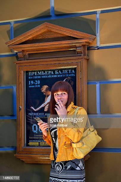 Girl smoking outside Philharmonic Hall .
