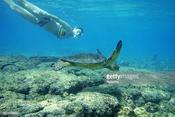 Girl Snorkeling with Sea Turtle