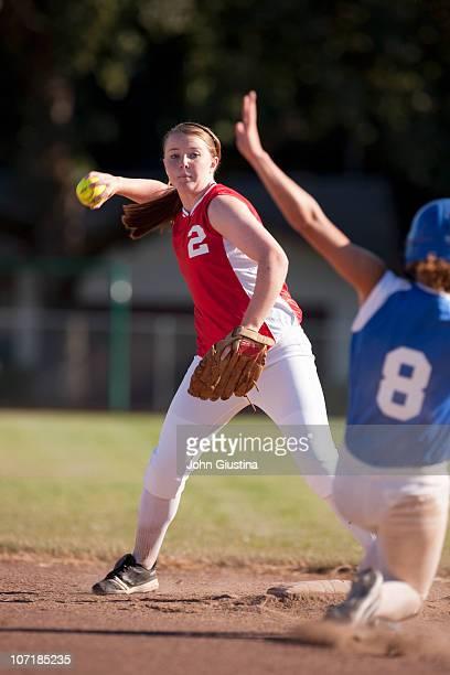 Girl softball player making a throw.