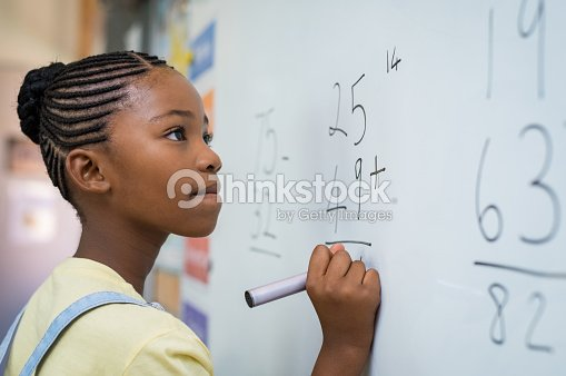 Girl solving mathematical addition : Stock Photo