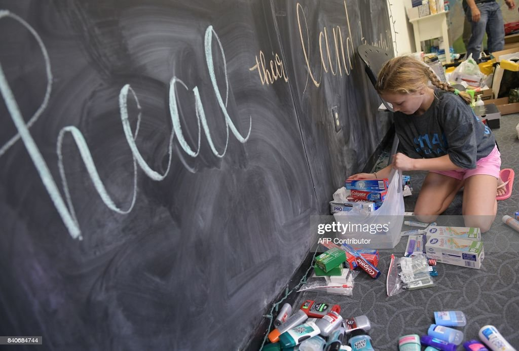 A girl sorts toiletries at a shelter for volunteer rescue workers set up at the Fairfield Baptist Church student building on August 29, 2017 in Cypress, Texas. The shelter was set up as a place to rest for volunteer rescue workers who had come to the Houston area in the aftermath of Hurricane Harvey. Harvey has set what forecasters believe is a new rainfall record for the continental US, officials said Tuesday. Harvey, swirling for the past few days off Texas and Louisiana has dumped more than 49 inches (124.5 centimeters) of rain on the region. NGAN