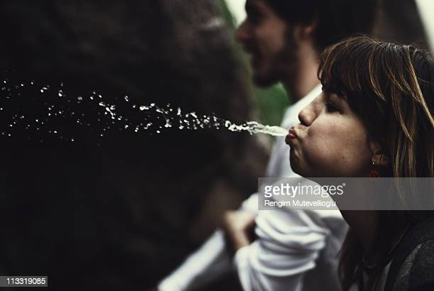 Girl spitting water