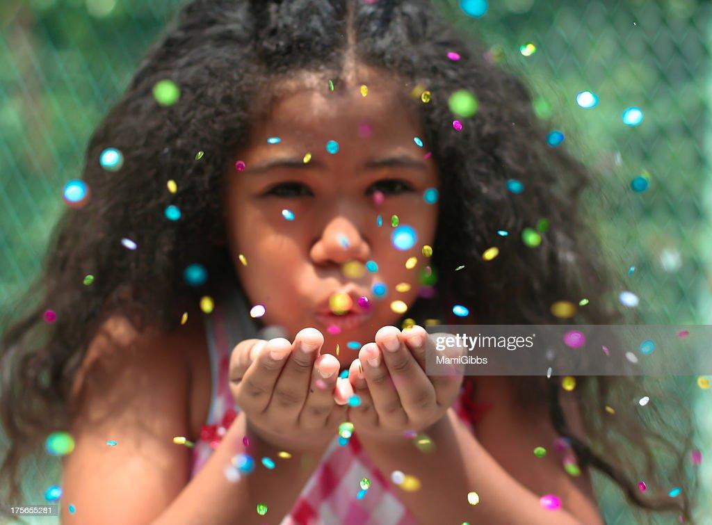 Girl spreading many color spangles