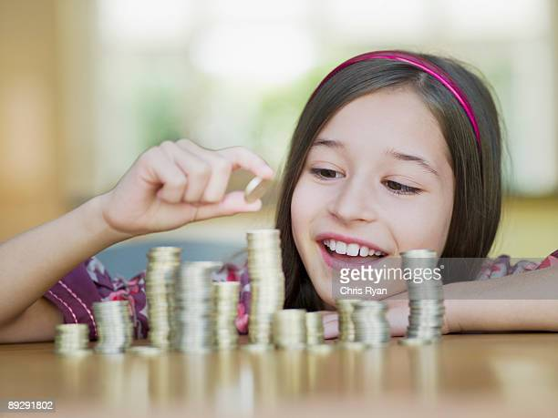Girl stacking coins