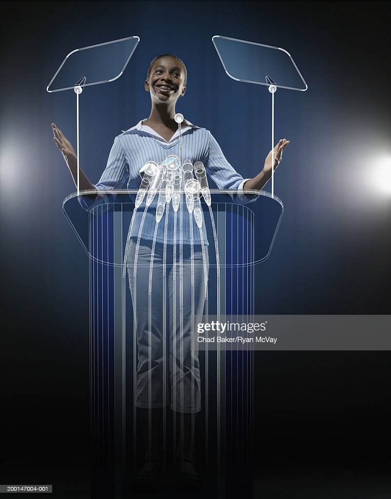 Girl (10-12) standing at podium (Digital Composite) : Stock Photo