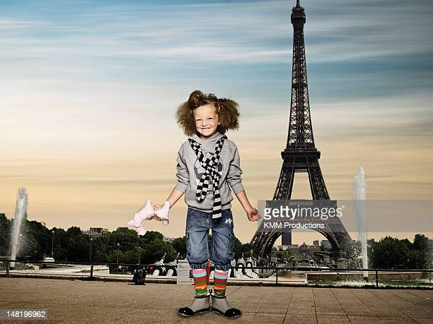 Girl standing by the Eiffel Tower