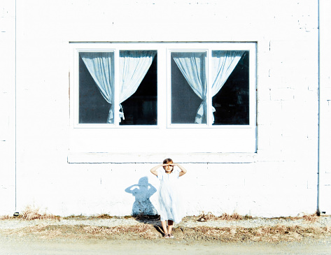 Girl Standing by Window