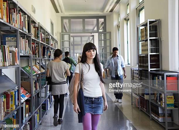 girl standing in busy school corridor