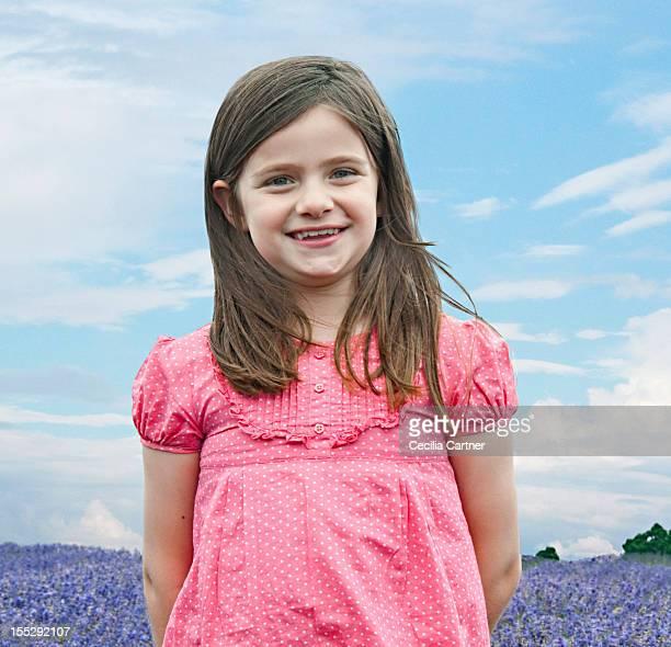 Girl standing in field of flowers