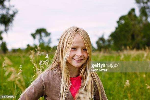 Girl standing in field