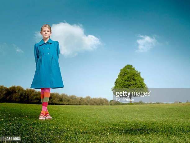Girl standing in rural field