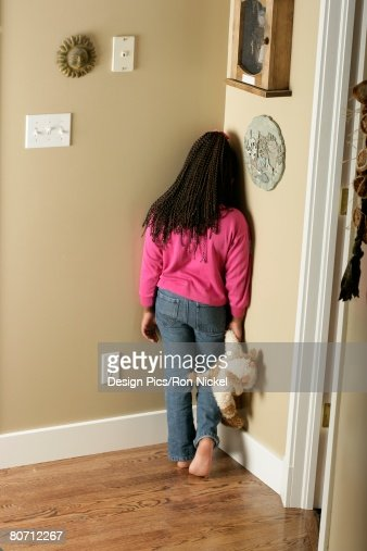 Standing In The Corner : Girl standing in the corner stock photo getty images