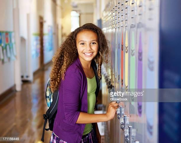 Girl standing near the locker