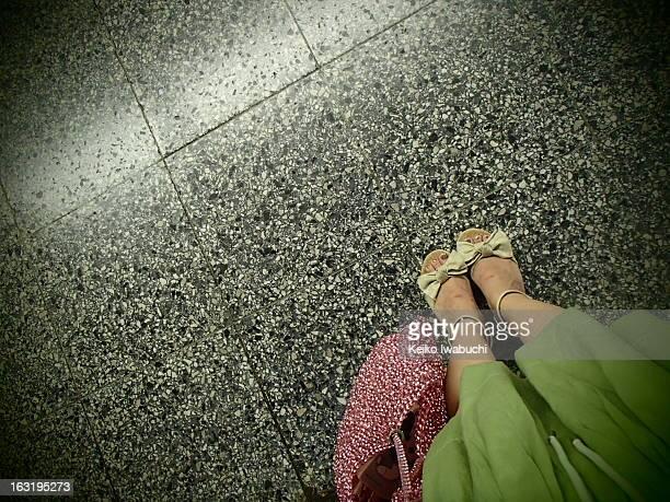 girl standing on platform
