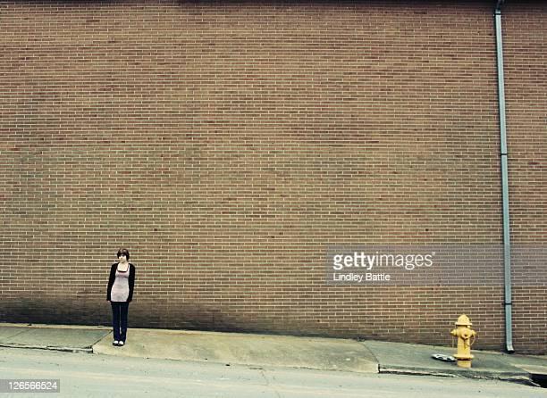 Girl standing on sidewalk