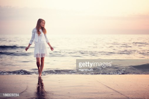 Girl Standing On The Beach At Sunset - 88.4KB