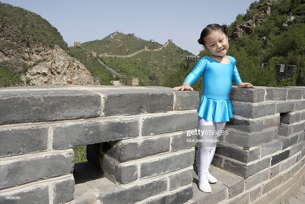 A girl standing on the Great Wall of China. : Stock Photo