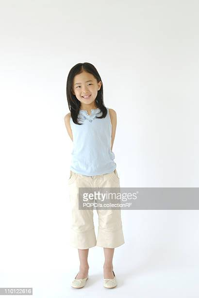 Girl Standing Portrait Looking At Camera Smiling