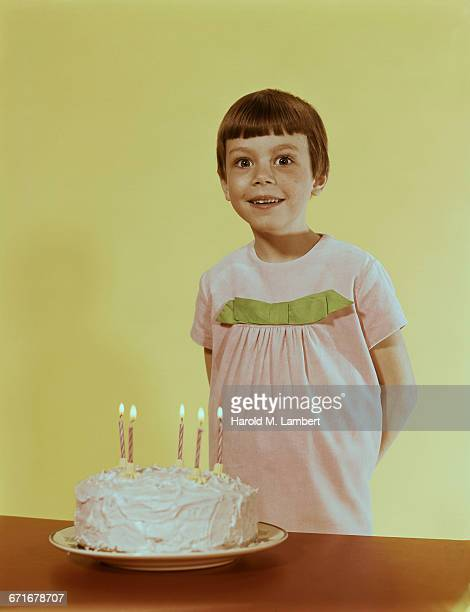 Girl Standing With Birthday Cake