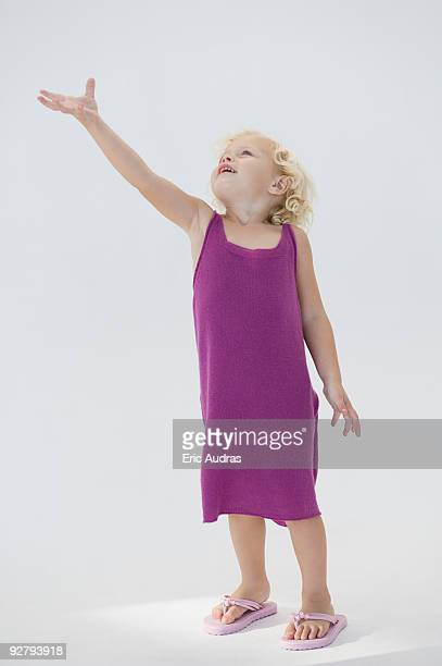 Girl standing with her hand raised