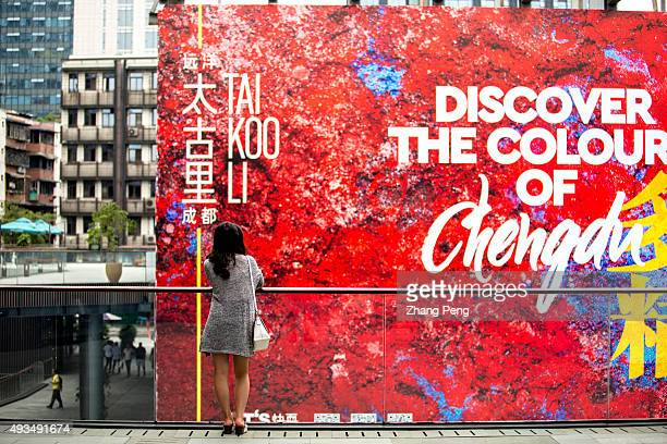 A girl stands in front of the huge billboard of Chengdu Tai Koo Li On Oct7 SinoOcean Taikoo Li Chengdu a 100000 sqm openplan lanedriven retail...
