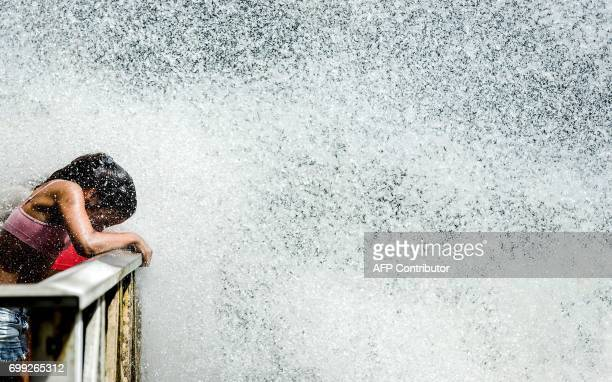 A girl stands in the Duinrell amusement park on June 21 2017 in Wassenaar as Europe sizzled in a continentwide heatwave Thermometers were still...