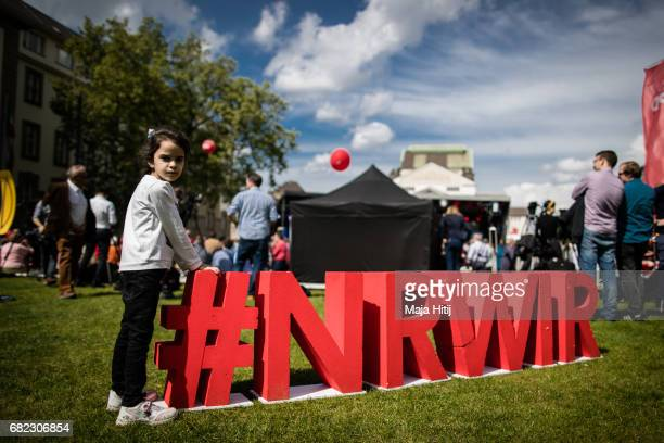 A girl stands next to SPD logo near the stage at the final SPD campaign rally in state elections in North RhineWestphalia on May 12 2017 in Duisburg...