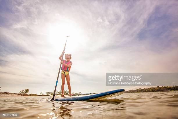 Girl standup paddleboarding in the sound, Fort Walton, Florida, USA