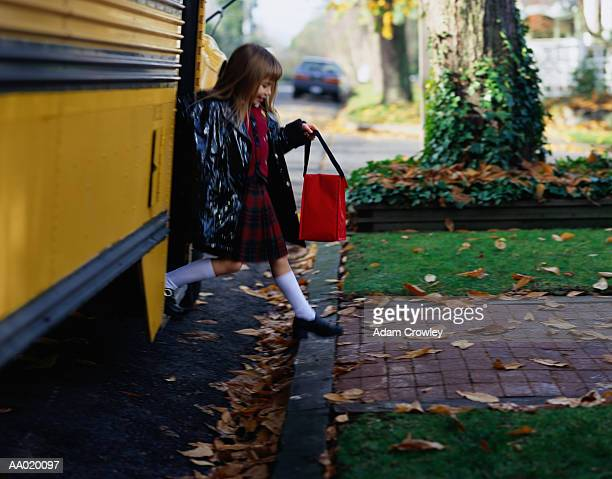 Girl Stepping off of a School Bus