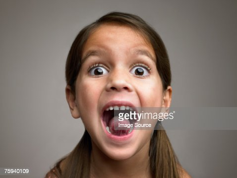 Girl sticking out tongue : Stock Photo