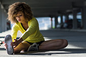 Portrait of mixed race girl tying a shoelace before workout