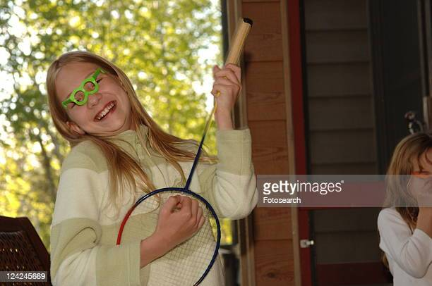 Girl strumming on a badminton racket