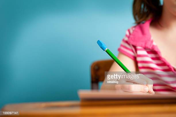 Girl Student Doing Work at School Desk, with Copy Space