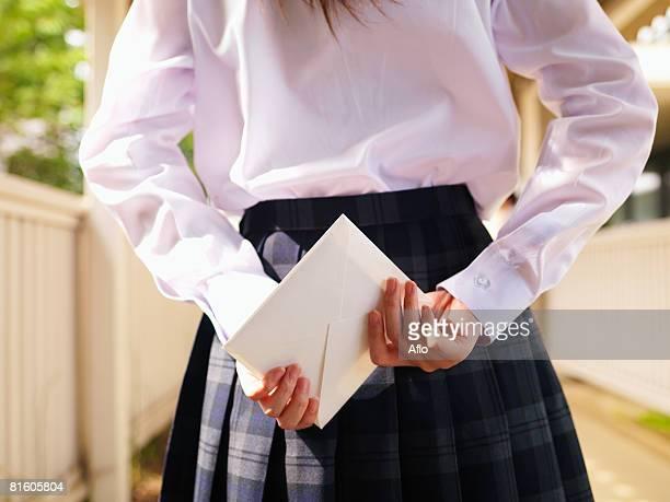 Girl Student Hiding Love Letter