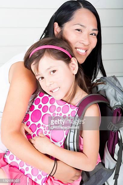 Girl student hugging mother