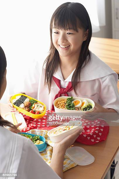 Girl students having lunch
