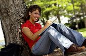 Girl studying under tree