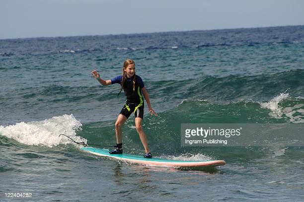 Girl surfing in Maui