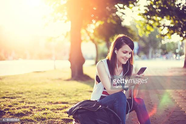 Girl surfing the net on smartphone