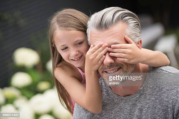 Girl surprising her father