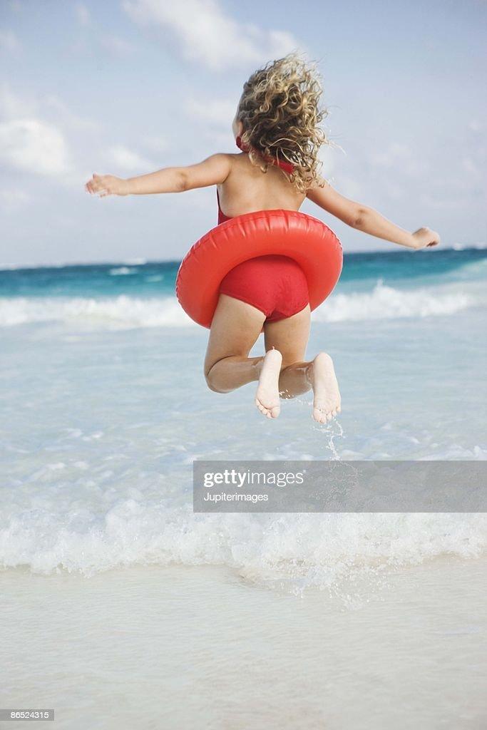 Girl swimming at the beach : Stock Photo
