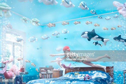 Girl swimming in her bedroom