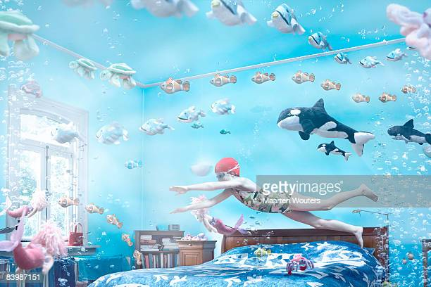 Girl swimming in her bedroom