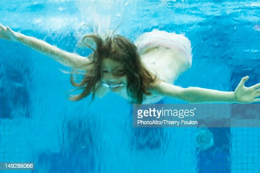Girl Swimming Underwater In Swimming Pool Stock Photo Getty Images