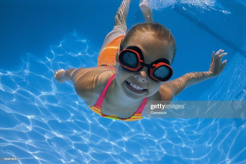 Girl swimming underwater : Stock Photo